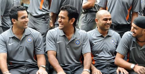Zaheer Khan, Mahendra Singh Dhoni, Virender Sehwag and Harbhajan Singh share a joke during at the official team photo opportunity in Mumbai. (AFP Photo)