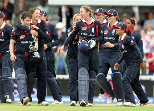 Claire Taylor and Beth Morgan are congratulated by the team after scoring the winning runs during their ICC World Twenty20 womens' semi-final match against Australia at the Oval. (AP Photo)