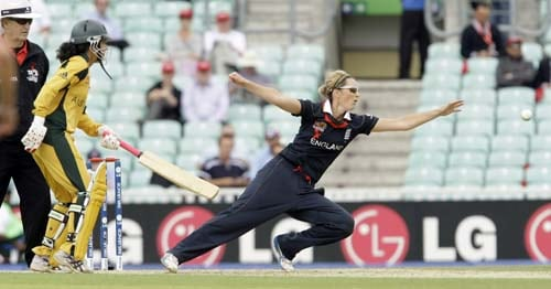 Charlotte Edwards tries to stop a ball during the ICC World Twenty20 womens' semi-final match between England and Australia at The Oval. (AP Photo)