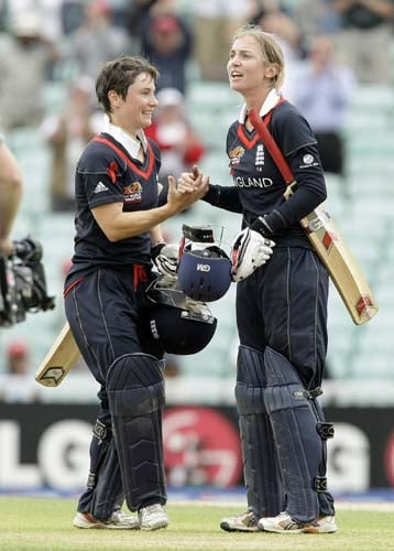 Beth Morgan celebrates with Claire Taylor after hitting the winning runs during the ICC World Twenty20 womens' semi-final match between England and Australia at The Oval. (AP Photo)
