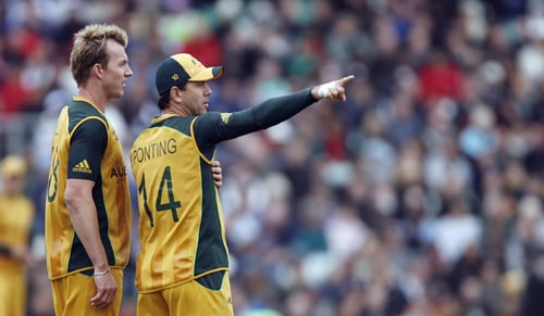 Brett Lee talks to Ricky Ponting during their ICC World Twenty20 match against the West Indies at The Oval in London. (AFP Photo)