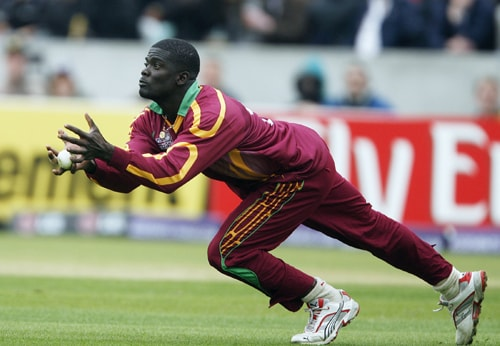Andre Fletcher of the West Indies catches David Hussey for 27 runs during their ICC World Twenty20 match against Australia at The Oval in London. (AFP Photo)