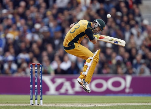 Michael Clarke of Australia avoids a bouncer from Jerome Taylor during their ICC World Twenty20 match against the West Indies at The Oval in London. (AFP Photo)