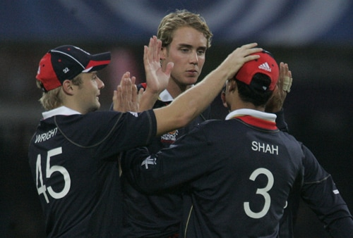 Stuart Broad celebrates with teammates Luke Wright and Owais Shah after taking the wicket of Darron Reekers in their Twenty20 World Cup match at Lord's in London. (AP Photo)