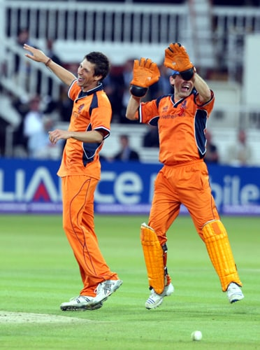 Jeroen Smits congratulates Pieter Seelaar after he claims the wicket of Paul Collingwood during their Twenty20 World Cup match at Lord's in London. (AP Photo)