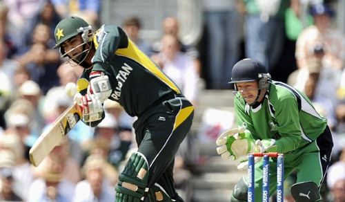 Shahzaib Hasan hits a shot in front of Niall O'Brien during an ICC World Twenty20 match at the Oval in London. (AFP Photo)