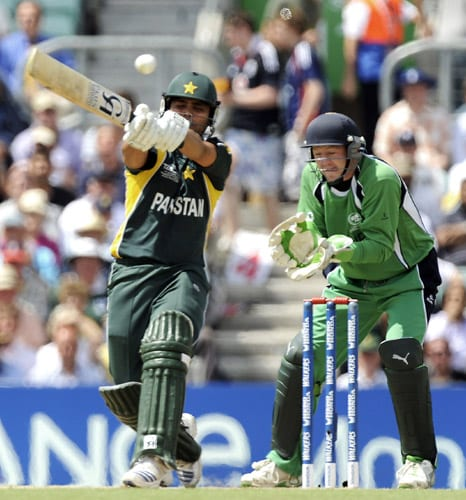 Kamran Akmal plays a shot as Niall O'Brien reacts during their ICC World Twenty20 match at the Oval in London. (AFP Photo)