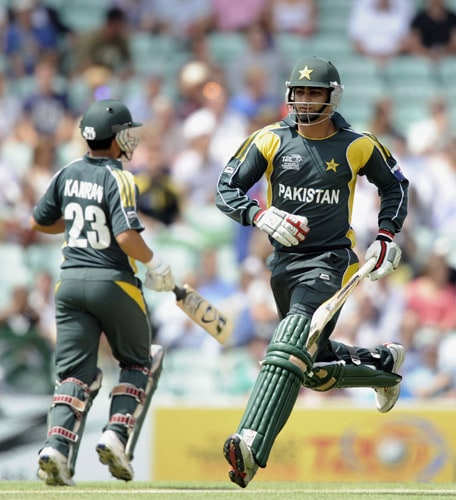 Shahzaib Hasan and Kamran Akmal run to complete a run during an ICC World Twenty20 match against Ireland at the Oval in London. (AFP Photo)