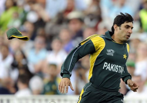 Misbah ul-Haq loses his cap while chasing after the ball against Ireland during an ICC World Twenty20 match at the Oval in London. (AFP Photo)