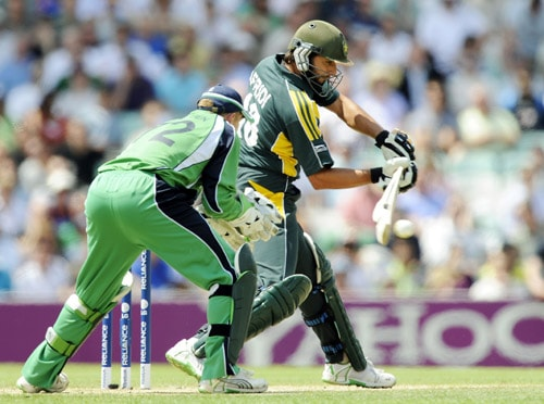 Shahid Afridi hits a shot in front of Niall O'Brien during an ICC World Twenty20 match at the Oval in London. (AFP Photo)