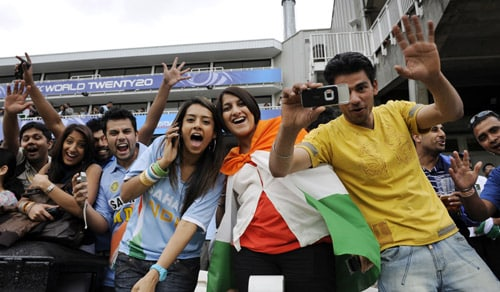 Crickets fans cheer for a photograph prior to the India versus Pakistan match in an ICC World Twenty20 warm-up match at the Oval in London. (AFP Photo)