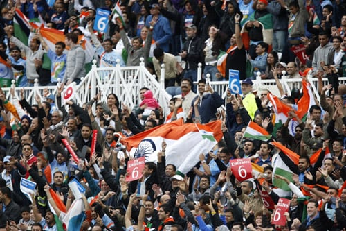 Indian fans celebrate a six during the team's win over Bangladesh in their ICC World Twenty20 match at Trent Bridge ground in Nottingham. (AP Photo)