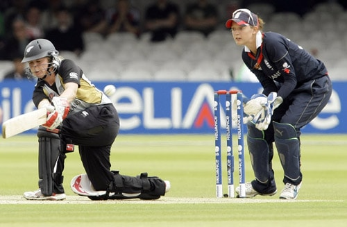 Lucy Doolan plays a ball off the bowling of Katherine Brunt, watched by Sarah Taylor during their ICC World Twenty20 Women's Final match at Lord's. (AP Photo)