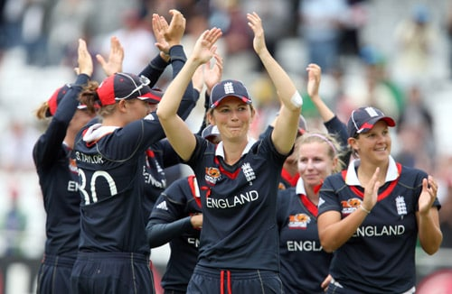 Charlotte Edwards celebrates with her team as they beat New Zealand to win their ICC World Twenty20 Women's Final match at Lord's. (AP Photo)