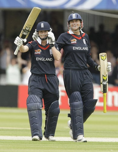 Claire Taylor and Jenny Gunn celebrate as they beat New Zealand to win their ICC World Twenty20 Women's Final match at Lord's. (AP Photo)