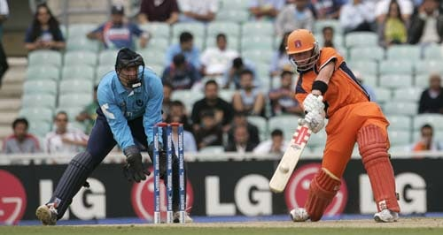 Netherland's Alexi Kervezee hits out watched watched by Scotland's wicket keeper Colin Smith in their warm-up match for the Twenty20 World Cup match at the Oval in London, on Wednesday. (AP Photo)