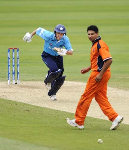 Scotland's Glenn Rogers runs between the wickets as he bats against the bowling of Mudassar Buhkari of the Netherland's during an ICC World Twenty20 World Cup warm-up match at the Oval, in London, on Wednesday. (AFP Photo)