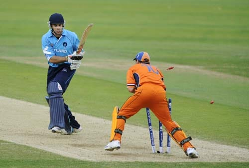 Scotland's Kyle Coetzer turns to see the bales knocked off by Netherland's wicket keeper Jeroen Smits during an ICC World Twenty20 World Cup warm-up match at the Oval, in London, on Wednesday. (AFP Photo)