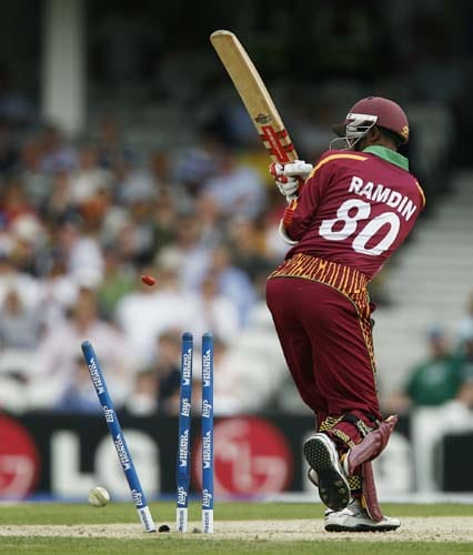 Denesh Ramdin is bowled by Dale Steyn during the ICC World Twenty20 match at the Oval in London. (AFP Photo)