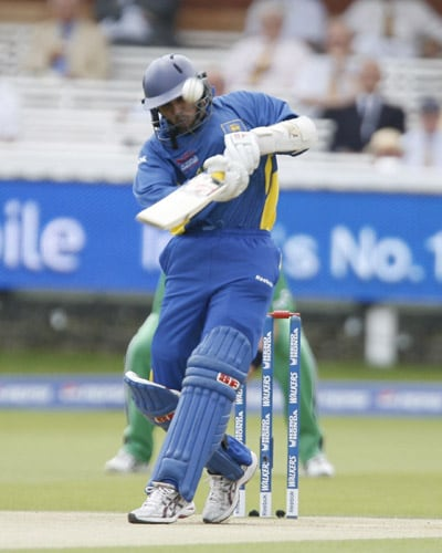 T.M. Dilshan is caught out with this shot during the ICC World Twenty20 match at Lord's in London. (AFP Photo)