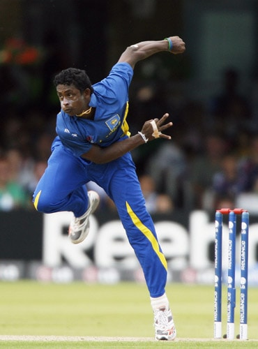 Ajantha Mendis bowls against Ireland during the ICC World Twenty20 match at Lord's in London. (AFP Photo)