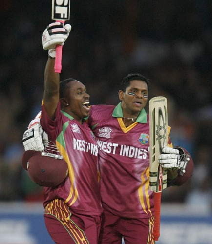 Dwayne Bravo celebrates getting the winning runs with Shivnarine Chanderpaul and beating India during the ICC World Twenty20 match at Lord's in London. (AFP Photo)