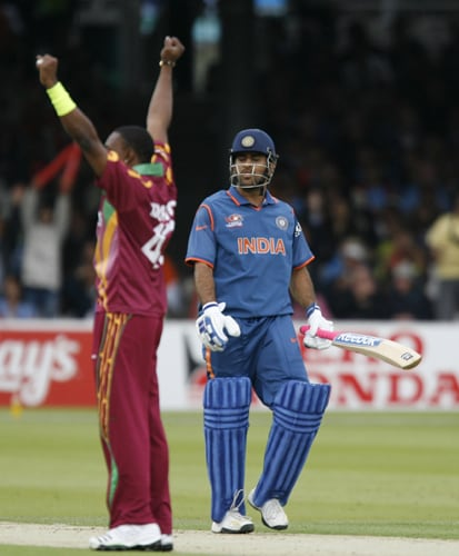 Dwayne Bravo celebrates taking the wicket of MS Dhoni caught by Andre Fletcher during the ICC World Twenty20 match at Lord's in London. (AFP Photo)