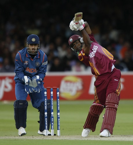 Dwayne Bravo plays a shot watched by Mahendra Singh Dhoni during the ICC World Twenty20 match at Lord's in London. (AFP Photo)