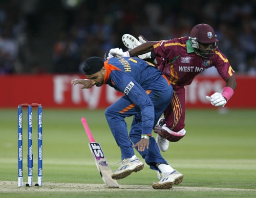 Dwayne Bravo collides with Harbhajan Singh after trying to avoid a runout during the ICC World Twenty20 match at Lord's in London. (AFP Photo)