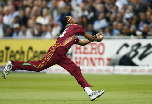 Lendl Simmons catches Gautam Gambhir during the ICC World Twenty20 match at Lord's in London. (AFP Photo)