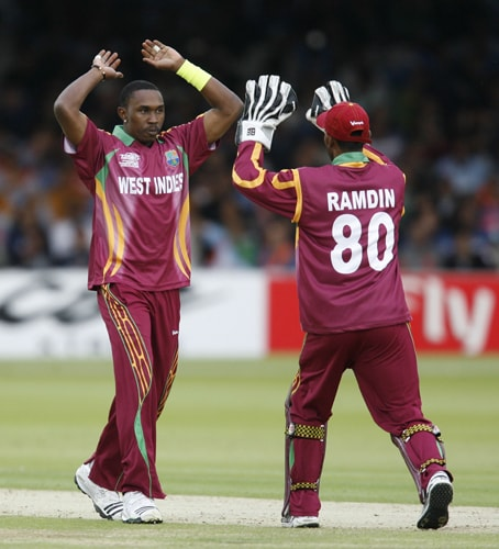 Dwayne Bravo celebrates the wicket of Yusuf Pathan during the ICC World Twenty20 match at Lord's in London. (AFP Photo)