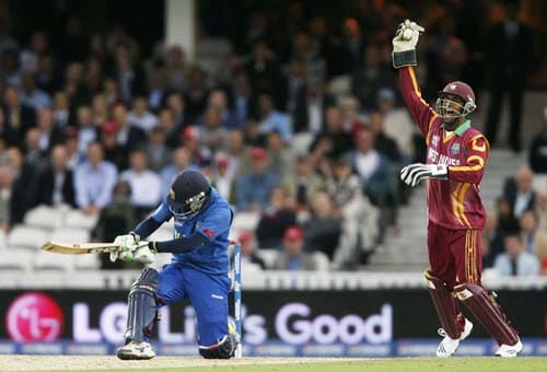 Denesh Ramdin celebrates catching Chamara Silva for 11 during the ICC World Twenty20 semi-final match at the Oval. (AFP Photo)
