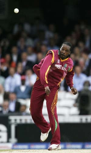 Chris Gayle bowls against Sri Lanka during the ICC World Twenty20 semi-final match at the Oval. (AFP Photo)