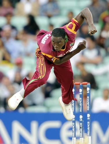 Jerome Taylor bowls against Sri Lanka during a ICC World Twenty20 semi-final match at the Oval. (AFP Photo)