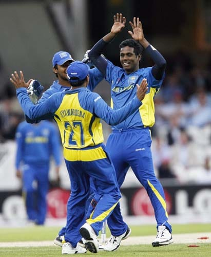 Angelo Mathews celebrates bowling Lendl Simmons for a duck during the ICC World Twenty20 semi-final match at the Oval. (AFP Photo)