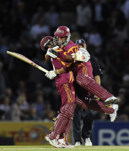 Ramnaresh Sarwan and Shivnarine Chanderpaul celebrate after defeating England during the ICC World Twenty20 match at the Oval in London. (AFP Photo)