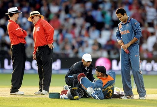 Harbhajan Singh receives treatment during the Super Eight stage of the ICC World Twenty 20 match against South Africa at Trent Bridge on June 16, 2009. (AFP Photo)