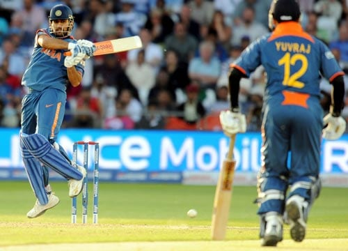 Mahendra Singh Dhoni plays a shot during the Super Eight stage of the ICC World Twenty 20 match against South Africa at Trent Bridge on June 16, 2009. (AFP Photo)