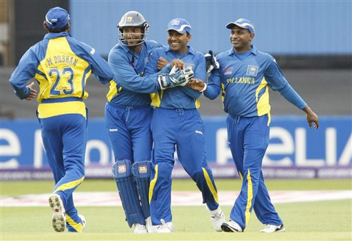 Sri Lanka's Mahela Jayawardene celebrates after catching West Indies' Lendl Simmons for 29 off the bowling of Muttiah Muralitharan during their World Twenty20 match at Trent Bridge cricket ground in Nottingham on Wednesday. (AP Photo)