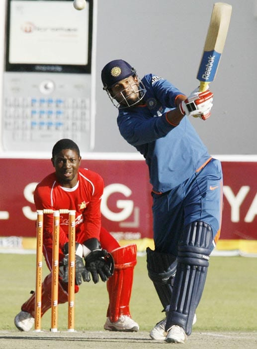 Indian batsman Yusuf Pathan plays a shot under the watchful eyes of Zimbabwe's wicket keeper Tatenda Taibu runs at Harare Sports Club in the first of the two matches of the Twenty 20 series . (AFP Photo)