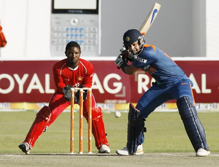 Indian batsman Virat Kohli plays a shot under the watchful eyes of Zimbabwe's wicket keeper Tatenda Taibu at Harare Sports Club in the first of the two matches of the Twenty 20 series . (AFP Photo)
