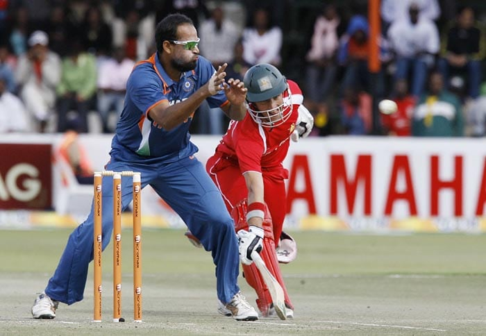India's Yusuf Pathan tries to run-out Zimbabwean batsman Craig Ervine at Harare Sports Club in the first of the two matches of the Twenty 20 series . (AFP Photo)