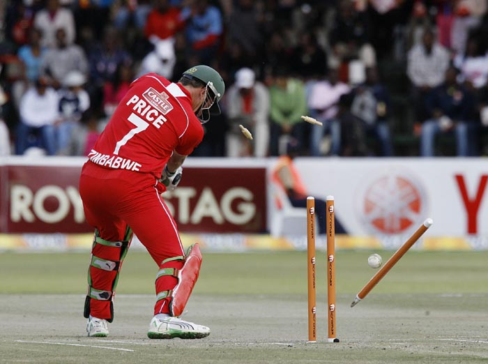 Zimbabwe batsman Raymond Price loses his wicket off Indian Ashok Dinda's bowling at Harare Sports Club in the first of the two matches of the Twenty 20 series . (AFP Photo)