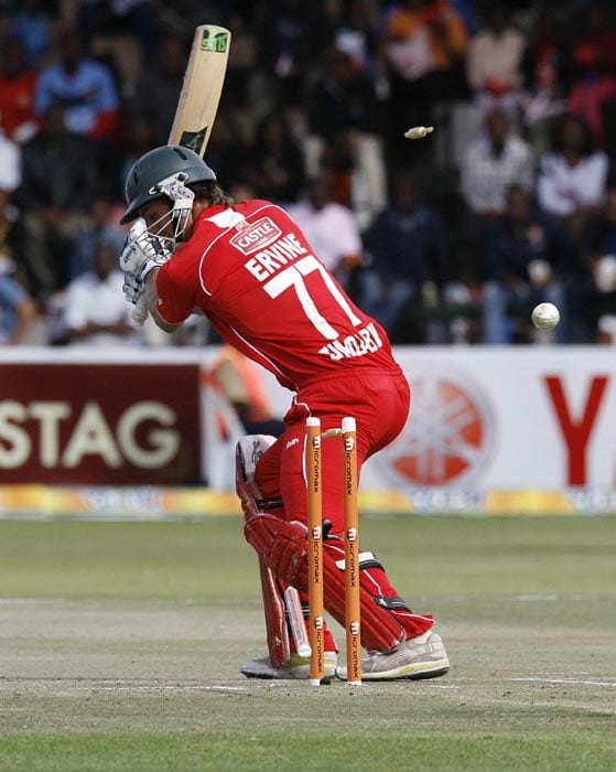 Zimbabwe batsman Graig Richard Ervine loses wicket off Indian Ashok Dinda's bowling at Harare Sports Club in the first of the two matches of the Twenty 20 series . (AFP Photo)