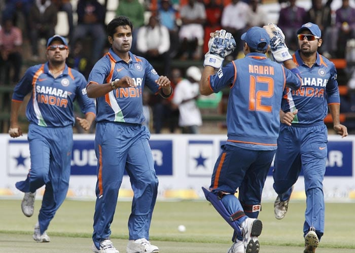 Indian players celebrate after Zimbabwe batsman Hamilton Masakadza is dismissed early in the Zimbabwe innings off the bowling of Vinay Kumar at Harare Sports Club in the first of the two matches of the Twenty 20 series . (AFP Photo)