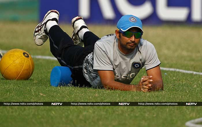 After an injury to Yuvraj Singh while playing barefoot football, Team India opted to go back to their first love - cricket! <br><br>Ahead of the ICC World Twenty20 semifinal clash against South Africa, the players were seen sweating it out the 'conventional' way. (Images courtesy AP)