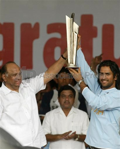 Dhoni, right, holds the trophy for T20 World Cup alongwith BCCI President Sharad Pawar at the ceremony.