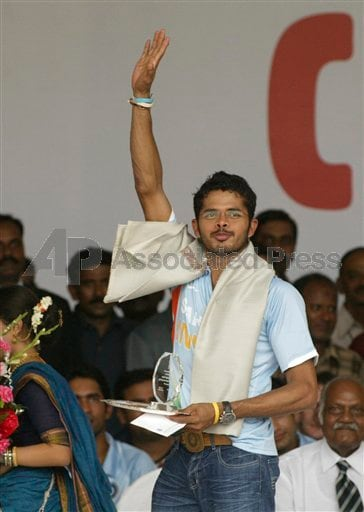 Indian cricket Twenty 20(T20) member S Sreeshanth acknowledges the crowd after receiving an award
