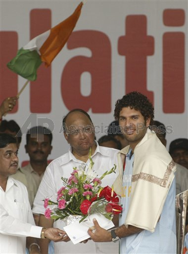 Indian cricket Twenty 20(T20) team vice-captain Yuvraj Singh, right, receives aan award and a cheque from Board of Control for Cricket in India President Sharad Pawar,