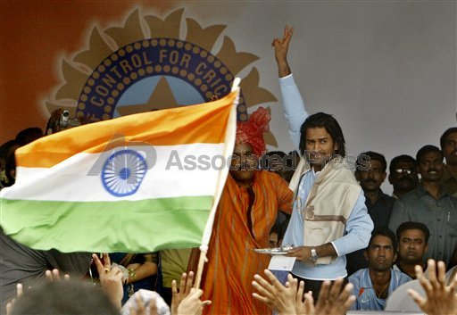 Dhoni gestures towards the crowd at a ceremony where the Indian T20 team was felicitated.